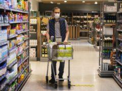 Shopper wearing a face mask in a supermarket in East London (Victoria Jones/PA)