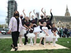 Arlene Phillips (left) joins in with a group of dancers as they perform during a protest calling for more funding for the performing arts in Parliament Square (Luciana Guerra/PA)