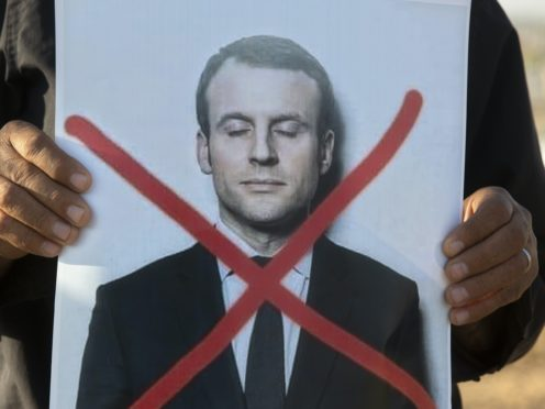 Protests have been held against the French president (AP Photo/Sebastian Scheiner)