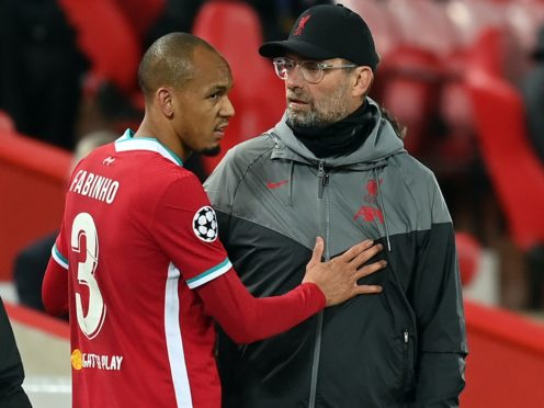 Klopp's injury issues are mounting as Fabinho (left) is sidelined (Michael Regan/PA)