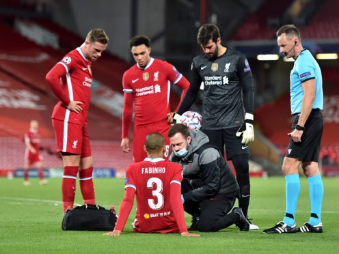 Liverpool's Fabinho is checked after suffering an injury during the Reds' Champions League Group victory over Mitjdylland (Peter Powell/PA)