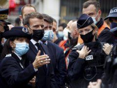 French President Emmanuel Macron, second left, meets police officers in Nice (Eric Gaillard/Pool via AP)
