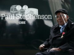 Dr Paul Stephenson next to the train bearing his name (Andrew Matthews/PA)