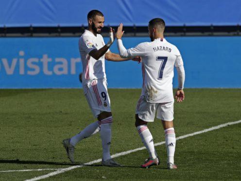 Karim Benzema (left) scored twice against Huesca, while Eden Hazard scord his first Real Madrid goal in a year (Manu Fernandez/AP).