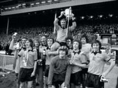 Mike Bailey is carried by his Wolves team-mates after their League Cup final win over Manchester City (PA)