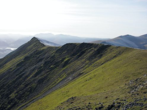A couple were attempting to climb Sharp Edge on Blencathra on Saturday when slippery conditions forced them to turn back and they got in trouble (PA)