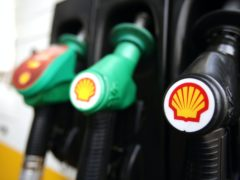 Shell logos on petrol pumps at a petrol station in London, as the board of BG Group has backed a takeover offer worth about £47 billion from Royal Dutch Shell.
