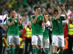 Craig Cathcart (centre) celebrates after Northern Ireland qualified for Euro 2016 (Niall Carson/PA)