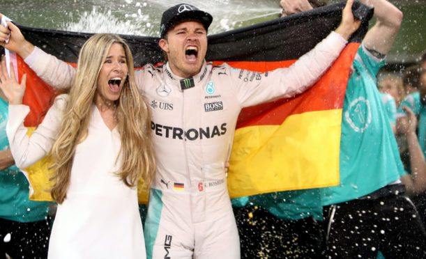 Nico Rosberg, pictured celebrating with wife Vivian, retired from Formula One just five days after winning his maiden world championship (David Davies/PA)