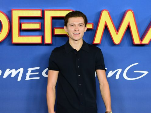 Tom Holland urged people to wear a mask as he shared a picture from the set of Spider-Man 3 (Ian West/PA)