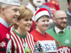 Nicola Sturgeon said she 'agonised over' the plan to relax restrictions over Christmas after being told a lack of impact assessment was 'deeply irresponsible' (John Linton/PA)