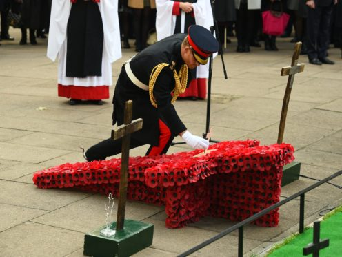 The Duke of Sussex places a cross on a memorial at the Field of Remembrance at Westminster Abbey, which has been organised by the Poppy Factory and held in the grounds of the abbey since November 1928.