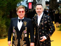 Sir Elton John, left, and husband David Furnish (Ian West/PA)