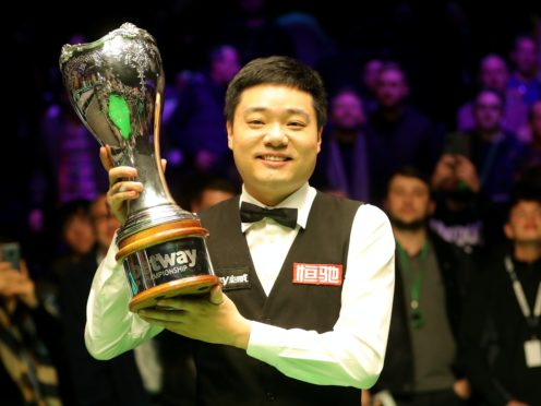 Ding Junhui is seeking to keep a grip on the UK Championship trophy (Richard Sellers/PA)