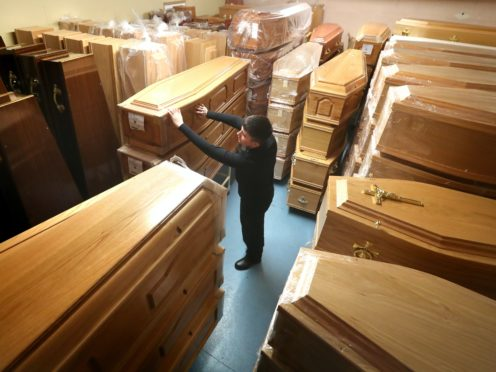 Dignity has seen a boost in sales but a fall in profits as restrictions hit funerals (Andrew Milligan/PA)