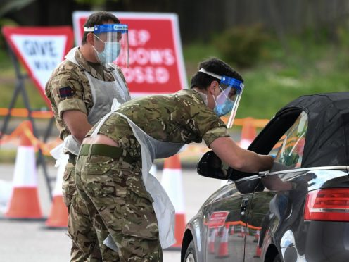 Members of the armed forces take swabs at a drive-in coronavirus testing facility at the Chessington World of Adventures Resort in south west London in May. (Kirsty O'Connor/PA Archive)