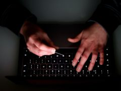 Almost 15,000 reports related to computer software service fraud were received by Action Fraud in the last year (Tim Goode/PA)