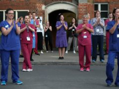 Hospital staff stand outside the Royal Hampshire County Hospital, to join in the Clap For Carers (Andrew Matthews/PA)
