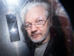 Julian Assange says he is in lockdown in Belmarsh prison after Covid-19 outbreak (Dominic Lipinski PA)