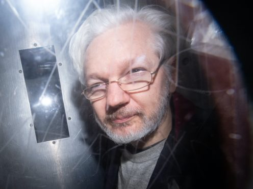 Julian Assange says he is in lockdown in Belmarsh prison after Covid-19 outbreak (Dominic Lipinski PA)