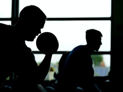 Gym users work out (John Walton/PA)