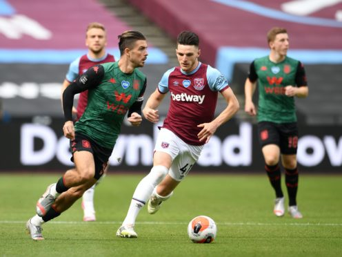 Jack Grealish (left) and Declan Rice (right) were in the Ireland set-up prior to switching allegiance to England (Andy Rain/PA).