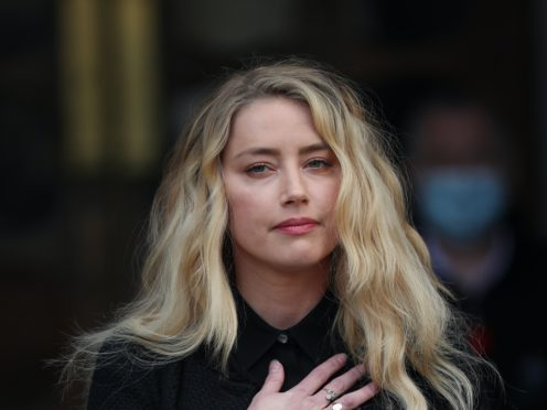 Actress Amber Heard gives a statement outside the High Court in London on the final day of the case (PA)