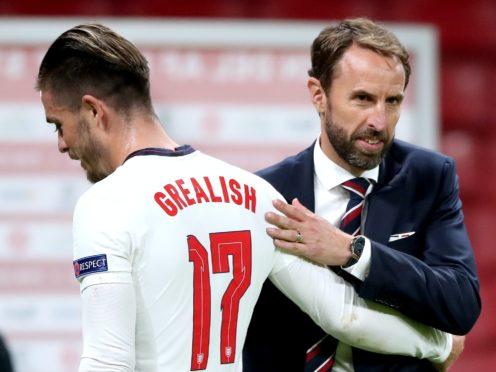 England manager Gareth Southgate, right, embraces Jack Grealish (Nick Potts/PA)