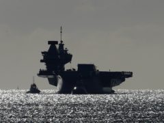 HMS Queen Elizabeth will deploy to the Mediterranean, Indian Ocean and East Asia next year under the plans (Gareth Fuller/PA)