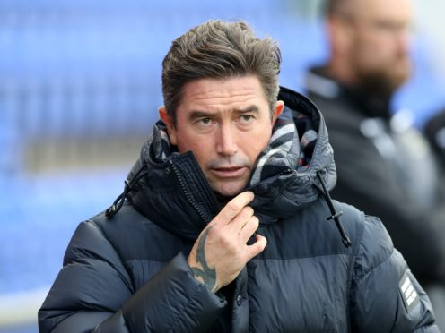 Harry Kewell, pictured, is back in the dugout for Oldham after completing his self-isolation period (Martin Rickett/PA)