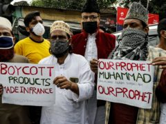Muslim activists from various organisations participate in a protest against France, near the French Consulate in Kolkata, India (Bikas Das/AP)