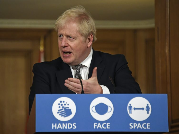 Prime Minister Boris Johnson during a media briefing in Downing Street (Alberto Pezzali/PA)