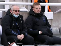 Everton goalkeeper Jordan Pickford (right) was on the bench at St James' Park (Alex Pantling/PA)