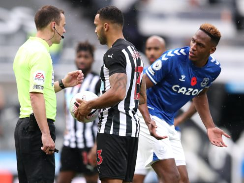 Everton's Yerry Mina (right) did his best to put off Newcastle's Callum Wilson as he prepared to take his penalty (Alex Pantling/PA)