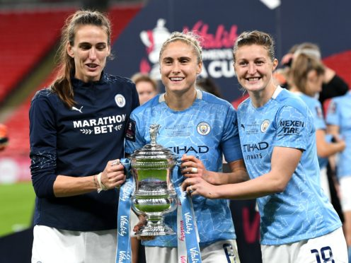 Steph Houghton, centre, and her Manchester City team-mates were still celebrating their Women's FA Cup win on Monday (Facundo Arrizabalaga/PA)