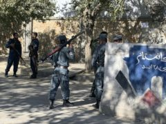 Afghan police at the site of an attack at Kabul University (AP/Rahmat Gul)