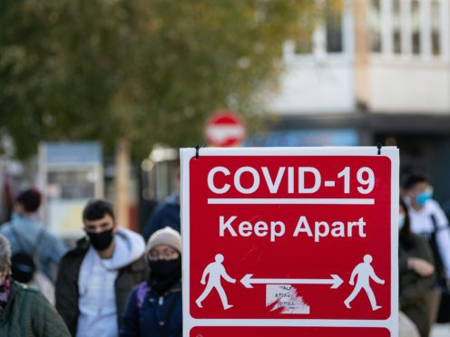 Covid-19 signage on Leicester high street, ahead of a national lockdown for England from Thursday (Joe Giddens/PA)
