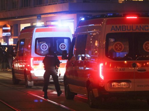 A police officer walks near ambulances at the scene after gunshots were heard, in Vienna, Monday, Nov. 2, 2020. Austrian police say several people have been injured and officers are out in force following gunfire in the capital Vienna. Initial reports that a synagogue was the target of an attack couldn't immediately be confirmed. Austrian news agency APA quoted the country's Interior Ministry saying one attacker has been killed and another could be on the run.(Photo/Ronald Zak)
