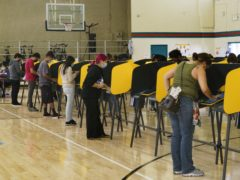 Voters fill out ballots on Election Day inside the Ruben F. Salazar Park recreation center, Tuesday, Nov. 3, 2020, in Los Angeles. (AP Photo/Damian Dovarganes)