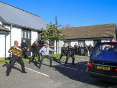 The Haka is performed as the hearse leaves the funeral service of police officer Sergeant Matt Ratana in Shoreham-by-Sea, West Sussex (Gareth Fuller/PA)