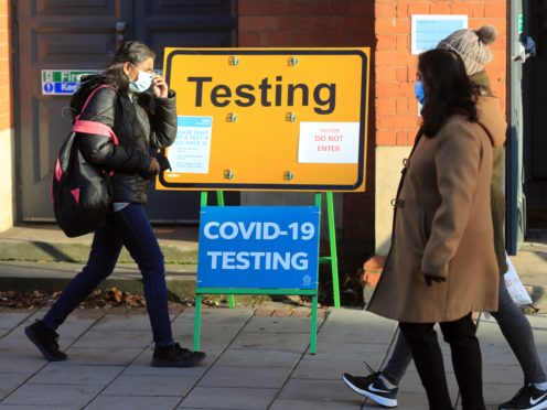 A Covid testing sign on Belgrave Road in Leicester (Mike Egerton/PA)