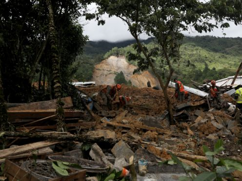 Search and recovery teams work in the debris of a massive landslide in the village of Queja in Guatemala (Esteban Biba/Pool Photo via AP)