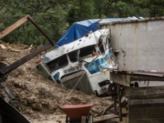 A lorry sits partially buried in a rain-fuelled landslide in the village of Queja, in Guatemala (Esteban Biba/Pool Photo/AP)