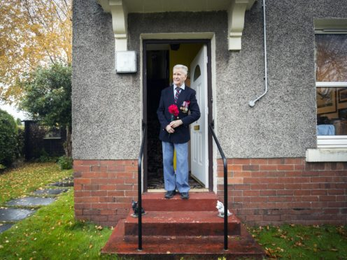 Bomber Command veteran Alastair Lamb, 95, observes a two-minute silence at 11am on Remembrance Sunday from his doorstep at his home in Stirling (Jane Barlow/PA)