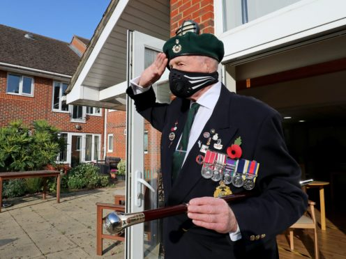 George Bradford, 90, a former Royal Marine, stands in a doorway at the RBLI home in Aylesford, Kent, during the two-minute silence (Gareth Fuller/PA)
