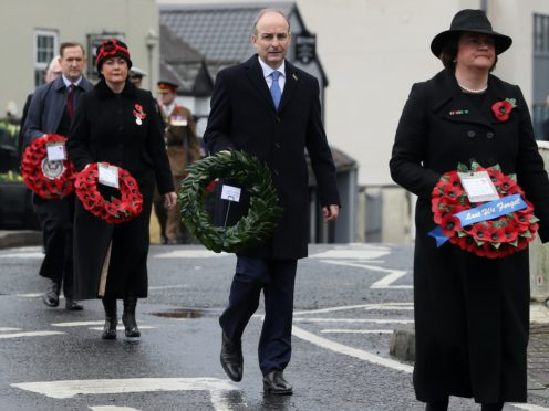 Taoiseach Micheal Martin (second right) with Northern Ireland First Minister Arlene Foster (right) during the Remembrance Sunday service (Brian Lawless/PA)
