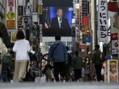 A screen in Shinjuku shopping district in Tokyo shows a broadcast of president-elect Joe Biden speaking on Sunday (Kiichiro Sato/AP)