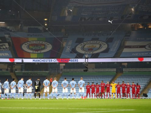 Manchester City and Liverpool players observe a minute's silence for Remembrance Sunday before the Premier League match at the Etihad Stadium (Shaun Botterill/PA)