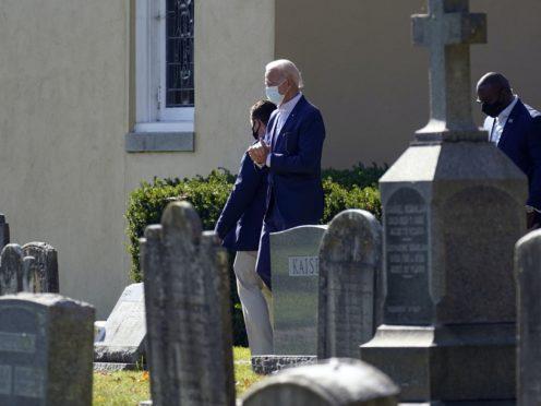 President-elect Joe Biden leaves after mass at St Joseph on the Brandywine Catholic Church in Delaware (Carolyn Kaster/AP)