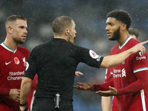 Joe Gomez (right) appeals to referee Craig Pawson after his handball resulted in a penalty for Manchester City (Clive Brunskill/PA)